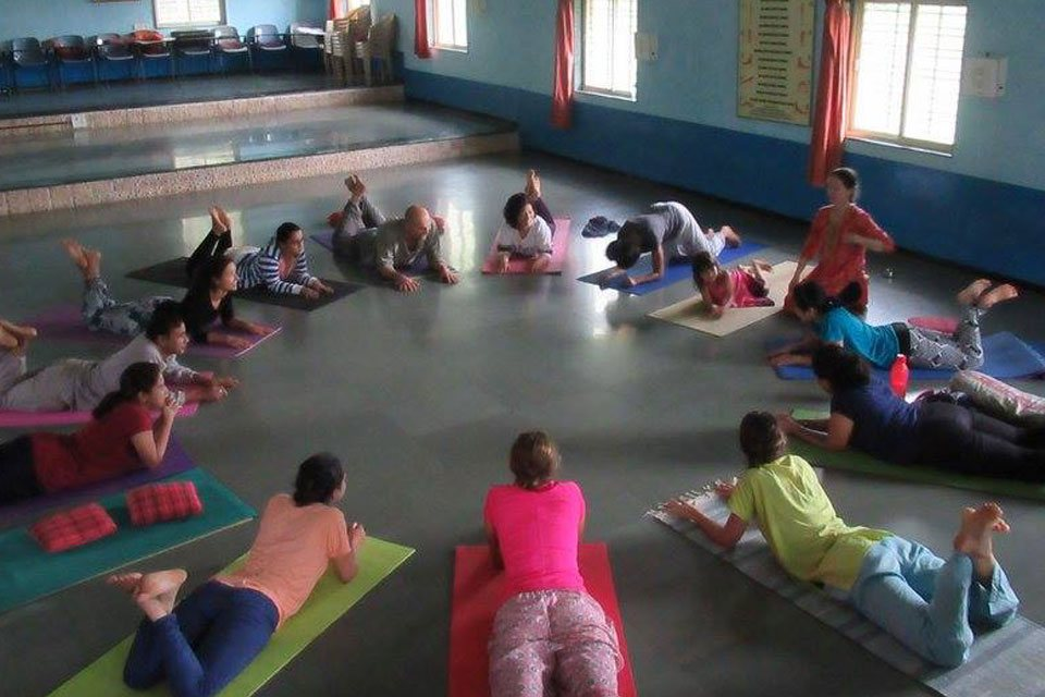 TTC students at Yoga Vidya Dham Practising Yoga