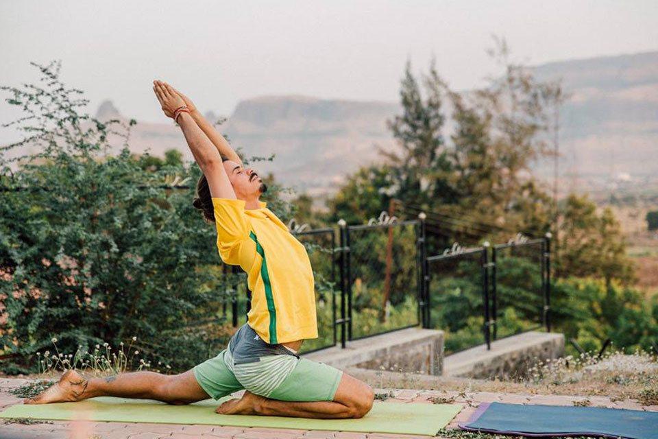 TTC Student Practising Warrior Thunderbolt Pose at Yoga Vidya Dham