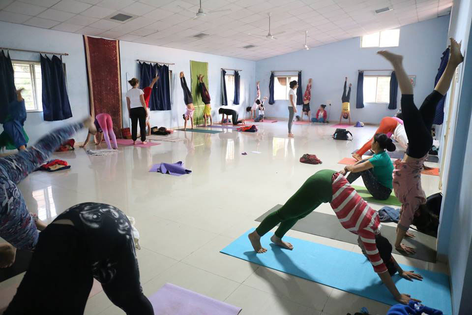 Yoga Students Practising Yoga at YogaPoint Yoga Teacher Training Classroom