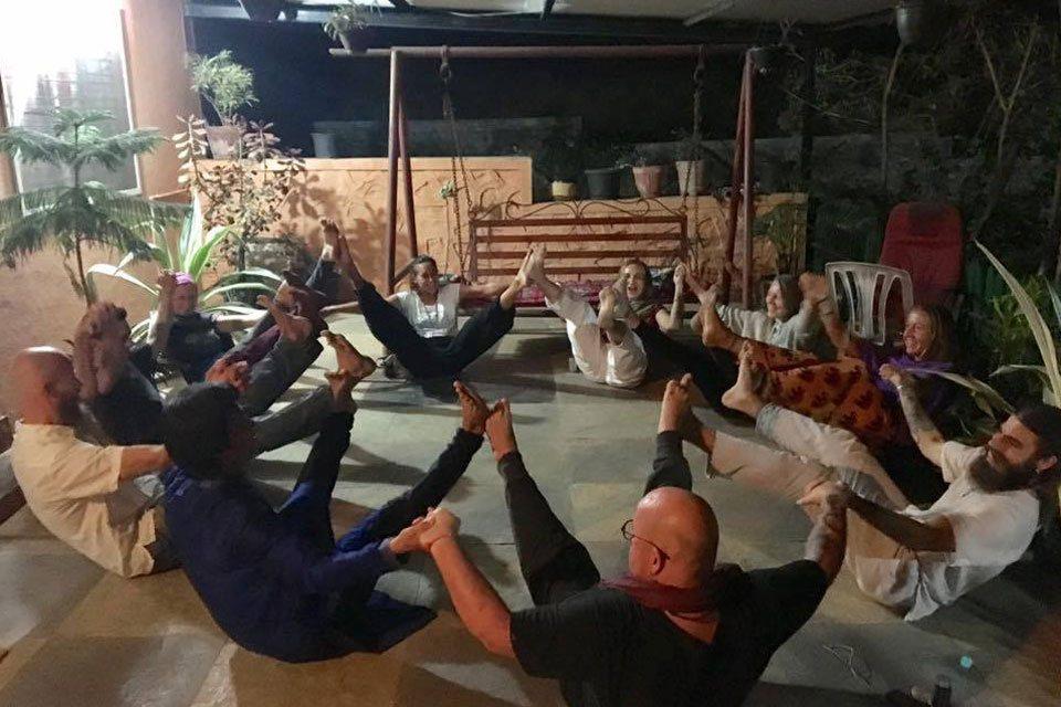 TTC students at Yoga Vidya Dham Practising Group Yoga in Fun Way