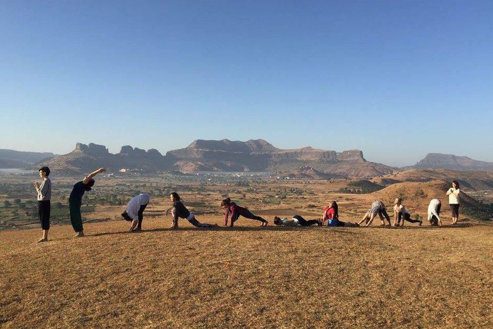 Yoga Students Enjoying Outdoor Sun-Saluatations at YogaPoint-Yoga Vidya Dham During Yoga Teacher Training Program