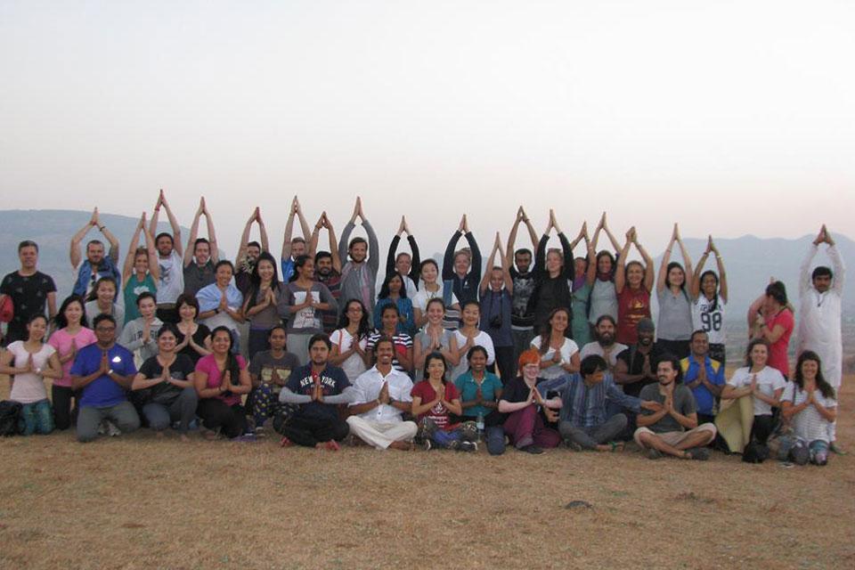 Yoga Students Enjoying Tree Pose at YogaPoint-Yoga Vidya Dham during Yoga Teacher Training Program
