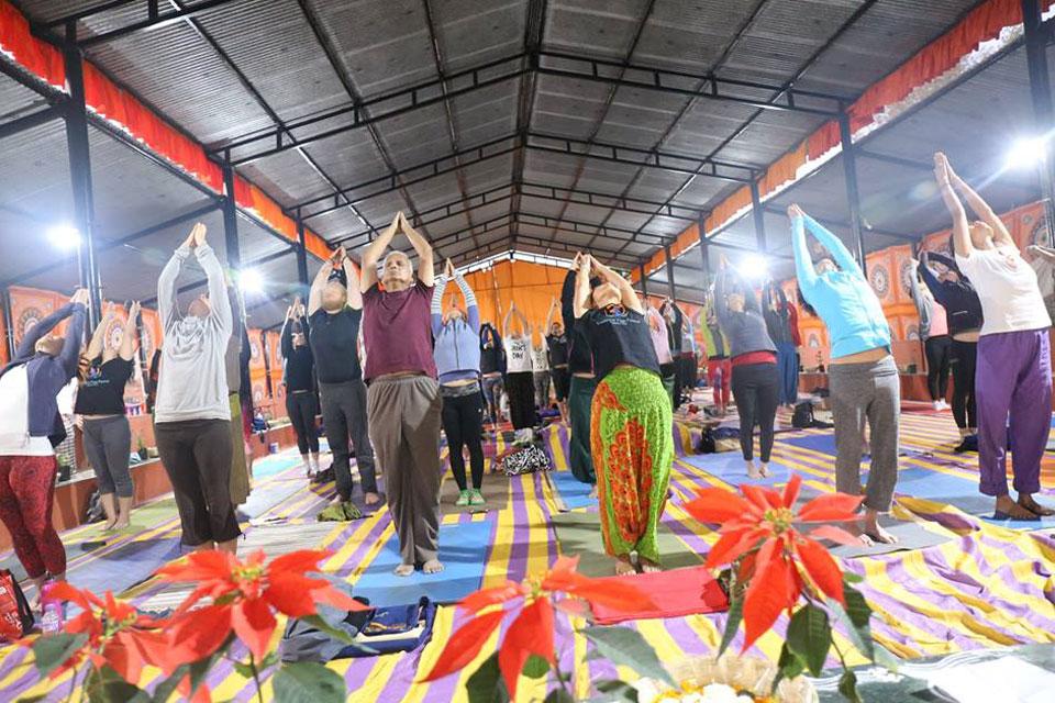 Yoga Students Preactising Yoga at YogaPoint Yoga Teacher Training Classroom